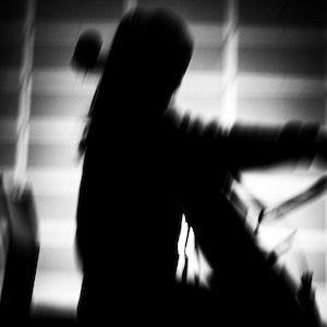 Skyggesilhuett av cellist