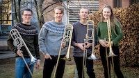 Gruppebilde av Nordic Trombone Quartet foran NMH