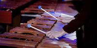 Hender som spiller marimba