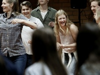 Students laughing in a group.